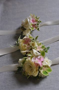 wrist corsages in whites and pink - clusters of smaller flowers Wrist Flowers, Prom Flowers, Bridal Flowers, Prom Corsage And Boutonniere, Corsage Wedding, Boutonnieres, Flower Corsage, Wrist Corsage, Wedding Coursage
