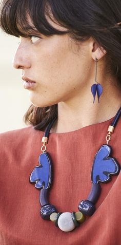 Elevate your look with the blue tones of the Pasmore Resin Leaf Necklace.