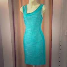 Teal Cocktail Dress Stretchy, comfortable and a great color! Can be dressed up or down! New with tags, never worn. Runs large, would fit an 8 or 10 Frank Lyman Dresses