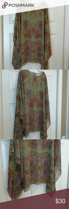 Sheer tunic blouse NWOT. Gorgeous sheer blouse that looks great with jeans and heels! In excellent condition! pic. shows true color. Linea by Louis Dell'Olio Tops