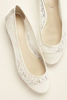This feminine and chic ballet flat is a great option for a special occasion or your everyday attire.  Elegant round toe with mesh lace sides the perfect comfy wedding shoe.  Built in padding provides extra comfort.  Material: Mesh Lace and Satin.  Heel Height: Flat.   Imported.
