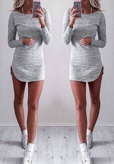 This grey melange curved-hem tunic is a stretchable piece that features a crew neckline, curved-hem and drop shoulder sleeves for a chic and relaxed style. Get this here with FREE shipping WORLDWIDE. | Lookbook Store