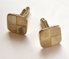 These would be right at home on MadMen's Don Draper's crisp white shirt cuffs. Goldtone Mother of Pearl Vintage Art Deco Cuff Links from www.hakallyhandmade.com.