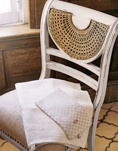 love this chair with painted wood and natural cane