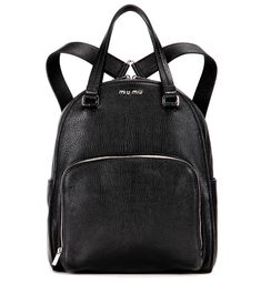 Miu Miu - Leather backpack - Miu Miu's backpack is shown in grainy black leather with a sheeny surface for an elevated take on the urban essential silhouette. A silver-tone logo to the front amps up the luxe factor. Carry yours by the top handles or swing it over your shoulder in the traditional, casual style. seen @ www.mytheresa.com
