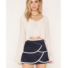 """Mini Skirt Host Pick. Black mini with white scalloped trimmed layers. Size s/p and above knee with side zipper. 13"""" in length front, 14"""" back. Thick stretchy material. 75% poly, 20% rayon and 5% elastane. NWT, never worn. Forever 21 Skirts Mini"""