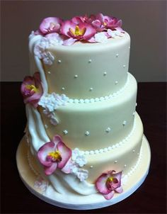 Ivory Wedding Cake with Pink Orchids and White Draping