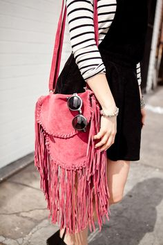 Urban Outfitters fringe bag and Quay sunnies