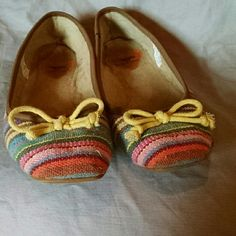 Beautiful colorful slip on moccasins These are used but still in good shape.  They are a little dirty on the inside from sitting in the garage but, they do not smell.  I got them second hand and almost never wore them.  They are not for people with wide feet like me. Shoes Moccasins