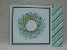 This wispy wreath was stamped with an avocado color and then clear embossed.  The teal color was sponged on later for a great pop of color, to match the striped inside paper.  This is perfect if you are looking for a non-traditional color for your handmade Christmas cards.