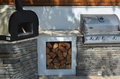 Pizza oven and Barbecue by Robert Hughes Garden Design