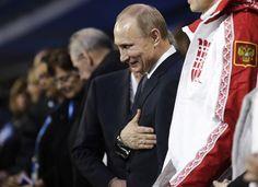 Vladimir Putin Photos Photos - Russian President Vladimir Putin stands during the 2014 Sochi Winter Olympics Closing Ceremony at Fisht Olympic Stadium on February 23, 2014 in Sochi, Russia. - 2014 Winter Olympic Games - Closing Ceremony
