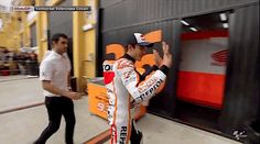 GIF - Marc Marquez MM93 - Hugs a young fan.