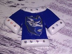 Polymer Clay T-Shirt Cabochon / Flat Backed - White and Blue details plus Swarovski Crystal Accents Zeta Phi Beta mask....$7,50 each