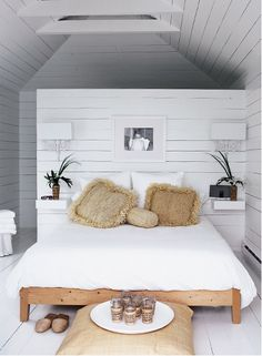 """Beachy Bedroom A sea of white creates the perfect casual retreat. In the boathouse's narrow upper-level bedroom, Michelle installed floating ledges flanking the bed. """"Having no tables or table lamps lends House Design, Home, Home Bedroom, Bedroom Design, House Styles, Beachy Bedroom, House Interior, Bedroom Inspirations, Scandinavian Design Bedroom"""