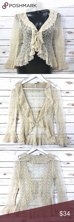 """FREE PEOPLE Romantic Crochet Cardigan FREE PEOPLE Romantic Crochet Cardigan Ethereal, featherweight, delicate Cardi Medium Amazing detail on this angelic light cardigan.  Beautifully embroidered with clear beading incorporated throughout. Delicate light knit  Mohair, nylon, acrylic thread Open front so bust measurement would very dependent on how you tie it - approx 18"""" bust 21"""" length in the front 26"""" length in the back  :::: Thank you for looking and please check out the rest of my closet…"""