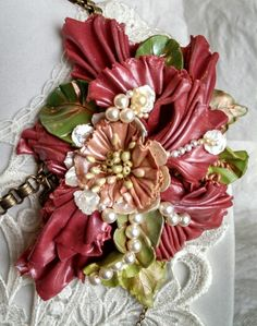 "Beautiful custom color polymer clay flower corsage on a vety large brass ox round filigree. Polymer leaves with accents of fresh water, Swarovski, and glass pearls. Brass ox Book Chain and small linked chain complete the ""Corsage"" necklace. Designed and created by Marcia Tuzzolino of Aurora Designs. $78 plus shipping."