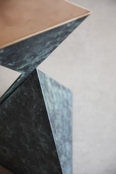 The base of our Ava table in bottle green bronze - made from 3 intersecting sheets of luxurious bronze
