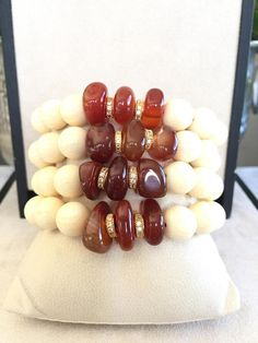 Set of 4 Bone Bead Carnelian Micro Pave Bracelet! I have hand-crafted these roundel creamy Bone Beads with these unique cut Carnelian Beads and separated them by couple of micro pave crystal cz bars. I have strung these bracelets on a strong elastic cord which makes the bracelets easy to