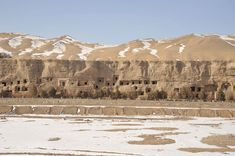 The Mogao Caves are carved into the face of a sandstone cliff at Dunhuang on the edge of the Gobi Desert. COURTESY PERRY HU