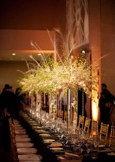 Dramatic tall white floral centerpieces from the Garden Gate floral.  Photo by Larry Sengbush-Photographer  #wedding #flowers #white #centerpiece