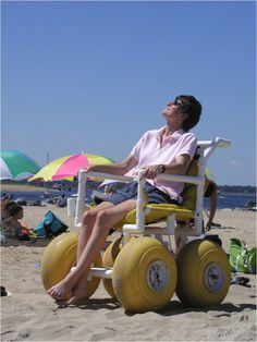 This is a beach wheelchair.  It's made of lightweight pvc pipe and has large wide wheels to facilitate moving the wheelchair across the beach without the wheels getting bogged down in the sand.