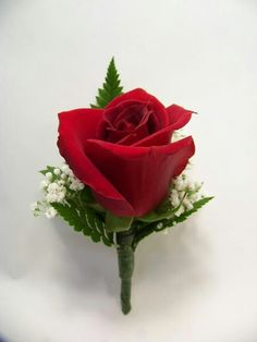boys Red Rose boutonniere, ease to make with a dozen red roses from the grocery store and make the night before