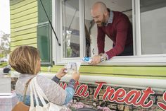 Garrett Eberle from the Randy Plaice and Associates team of Re/Max handing out ice cream on the Treat Suite at Triumph Actuation Systems in Santa Clarita.