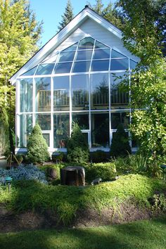 2 story glass wall, conservatory, greenhouse, built by Greenhouses, Etc.