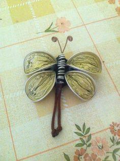 Mariposa realizada con cápsulas nespresso