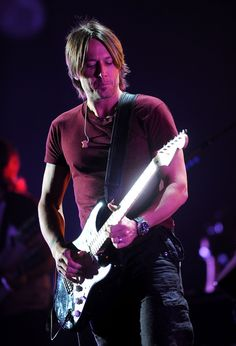 Keith Urban Musician Keith Urban performs onstage during Day 1 of rehearsals for the 2011 CMT Music Awards at Bridgestone Arena on June 7, 2011 in Nashville, Tennessee.