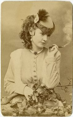 An original photo bought in San Franciso about 15 years ago. Its a classic image of Lotta Crabtree smoking a cigar. She was a major singer-actress in the 1880s earning up to 5K a week and when she died in 1924 she left an estate worth 4 million. She donated a fountain to San Fran at Market  Kearny where people meet to mark the anniversary of the 1906 earthquake. truewestmag