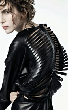 "Vilsbøl de Arce has won Design Talent of the Year at the 2010 Danish Fashion Awards. The label's Fall Collection is inspired by human anatomy:"" laser-cutting leather to resemble a rib cage splayed open, or a body undergoing a dissection. Other fabrics were quilted and ribbed to give the appearance of pulled musculature."""
