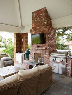 Outdoor Kitchen with fireplace and bluestone tiling. #OutdoorKitchen Cronk Duch Architecture.