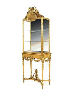 A Louis XVI style giltwood vitrine on stand