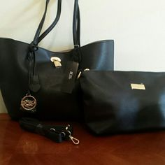 BCBG REVERSIBLE  HANDBAG SET TWO BAGS. SEE PHOTOS BCBG REVERSIBLE HANDBAG SET COMES  WITH AUDITIONAL BAG ONE SIDE BLACK AND ONE SIDE TAUPE OR A GRAY COLOR . SMALL BAG COMES WITH SHOULDER STRAP BCBG Bags Totes