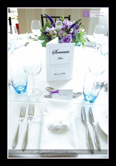 Table settings in a purple theme with tables named after Italian towns. nice place cards. I like the blue with purple for a wedding or bridal shower. Cost $100-$125
