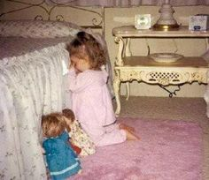 This is too cute! The baby and her dolls praying!  Reminds me of when my girls were young.