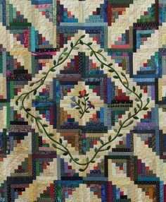"close up, ""Maryland Memories""by Audrey Mantle.  Log cabin quilt with appliqued vines and flowers.  2013 DVQG, photo by Quilt Inspiration"