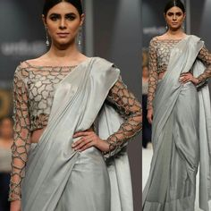 Featured is a cutwork blouse embellished with cut dana paired with plain silver grey saree curated in flowy silk. We recommend this dress for ladies with pear shaped body. Grey Saree, Lace Saree, Saree Dress, India Fashion, Ethnic Fashion, Modern Fashion, Blouse Styles, Blouse Designs, Trendy Suits