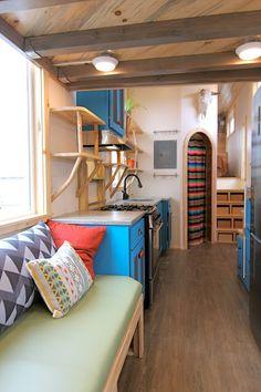 A custom-made tiny home by Mitchcraft Tiny Homes, built onto a 31' goosenech trailer.