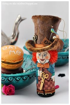 http://living-on-the-rainbow.blogspot.com/2013/01/hatter-my-cross-stitch-pattern.html#more
