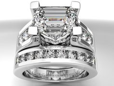 Modern Horizontal Emerald Cut diamond Engagement ring.....by far the most breathtaking wedding set I have EVER seen and it will be mine someday!!!!