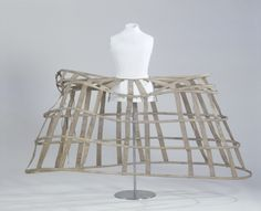 Large panniers, linen fabric and tapes and whalebone closed with hooks and sewn eyelets, c. 1760.