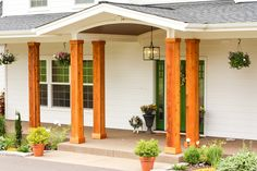 We turned the plain white front porch pillars on our house into cedar pillars, and we couldn't be happier with the results! Front Porch Pillars, Porch Beams, House Pillars, Porch Wood, Wood Columns Porch, Porch Ceiling, Cedar Porch Posts, Front Porch Posts, Front Porches
