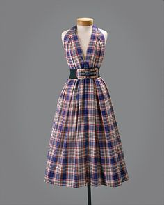 Dress Designer: Claire McCardell (American, 1905–1958) Manufacturer: Townley Frocks (American) Date: ca. 1956 Culture: American Medium: cotton, rubber, metal Dimensions: Length (cf to cb): 52 in. (132.1 cm)
