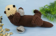 Please note that I sell PDF crochet patterns see Delivery Information below NOT completed items An original crochet amigurumi Sea Otter pattern by June Gilbank Sea Otters are both the Crochet Patterns Amigurumi, Crochet Dolls, Cute Crochet, Knit Crochet, Sea Otter, Crochet Instructions, Stuffed Animal Patterns, Crochet Animals, Otters