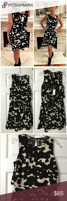 NWT Banana Republic Black/Ivory crepe dress! Stunning piece - sold out in stores and online back gold tone zip- appears to be a skirt and top in front- very flattering- ruffled hemline- fluid in back! Banana Republic Dresses