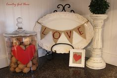 love this little burlap bunting across the white plate and the small framed burlap with heart