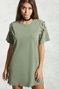 Forever 21 Contemporary - A mini T-shirt dress featuring lattice cutout short sleeves with metallic eyelets and a round neckline.